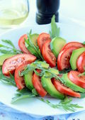 Salad with tomato and avocado — Stock Photo