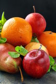 Fresh fruit apples pears tangerines — Stock Photo