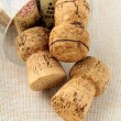 Cork from bottles of wine in the glass — Stock Photo #5153100