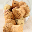 Cork from bottles of wine in the glass — Stock Photo #5172385