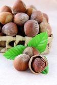 Hazelnut with a green leaf — Stock Photo