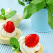 Stock Photo: Dessert tartlets with cream