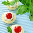 Dessert tartlets with cream,  cherry — Stok fotoğraf