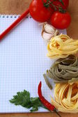 Notebook with pasta and vegetables for a menu — Stock Photo