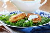 Potato patties with green salad — Stock Photo