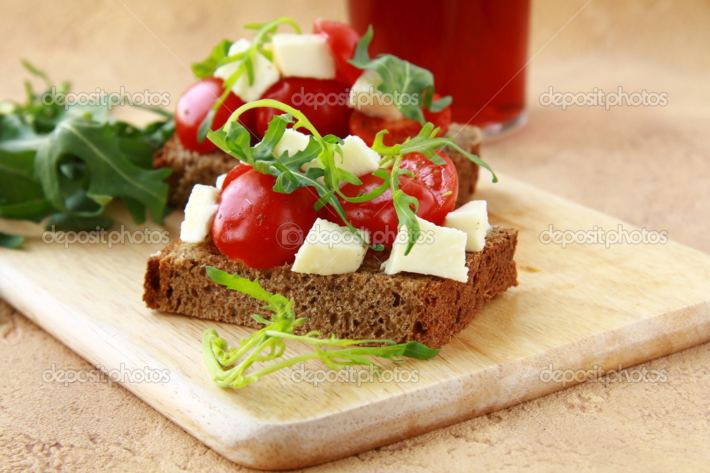 Sandwich with mozzarella and tomatoes on rye bread — Stock Photo ...