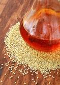 Sesame seeds and sesame oil — Stock Photo
