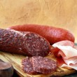 Assorted several kinds of sausages and smoked meats — Stock Photo