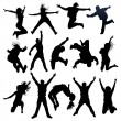 Jumping and flying silhouettes - Stok Vektr