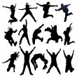 Jumping and flying silhouettes - Stockvectorbeeld