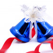 Blue christmas bells and red bow ribbon — Stock Photo