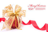 Red christmas balls and gold bow ribbon — Stock Photo