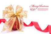 Red christmas balls and gold bow ribbon — Stock Photo