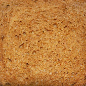 The cut of brown bread — Stock Photo