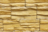 Wall with decorative relief tiles — Stock Photo