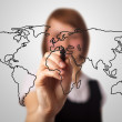 Businesswoman drawing the world map in a whiteboard — Stock Photo