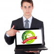 Business man pointing at a laptop computer — Stock Photo #5232294