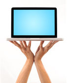 A male hand holding a laptop — Stock Photo