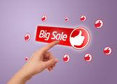 Hand pressing big sale button — Stock Photo