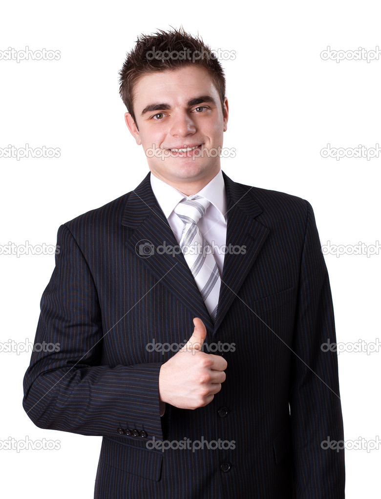 Portrait of a happy young business man showing thumbs up sign against white background  — Stock Photo #5232333