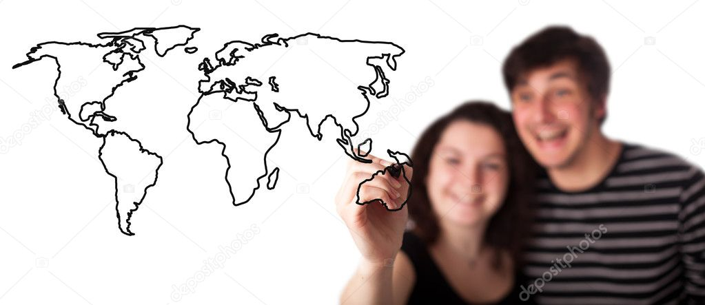 A picture of a young couple drawing a world map over white background   Stock Photo #5232428