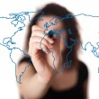 Woman drawing the world map in a whiteboard — Stock Photo
