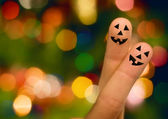 Halloween pumpkin finger hug — Stock Photo
