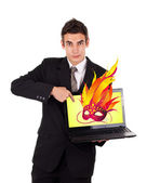 Business man pointing at a laptop with mask — Stock Photo