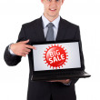 Business man pointing at a colorful sale label 3 — Stock Photo