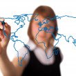Woman drawing the world map in a whiteboard 3 — Stock Photo
