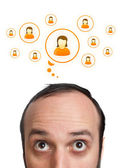 Funny Young man with social icons over head — Stock Photo