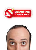 Young man with NO SMOKING sign over his head 2 — Zdjęcie stockowe