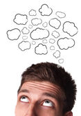Young man with Speech Bubbles over his head — Stock Photo