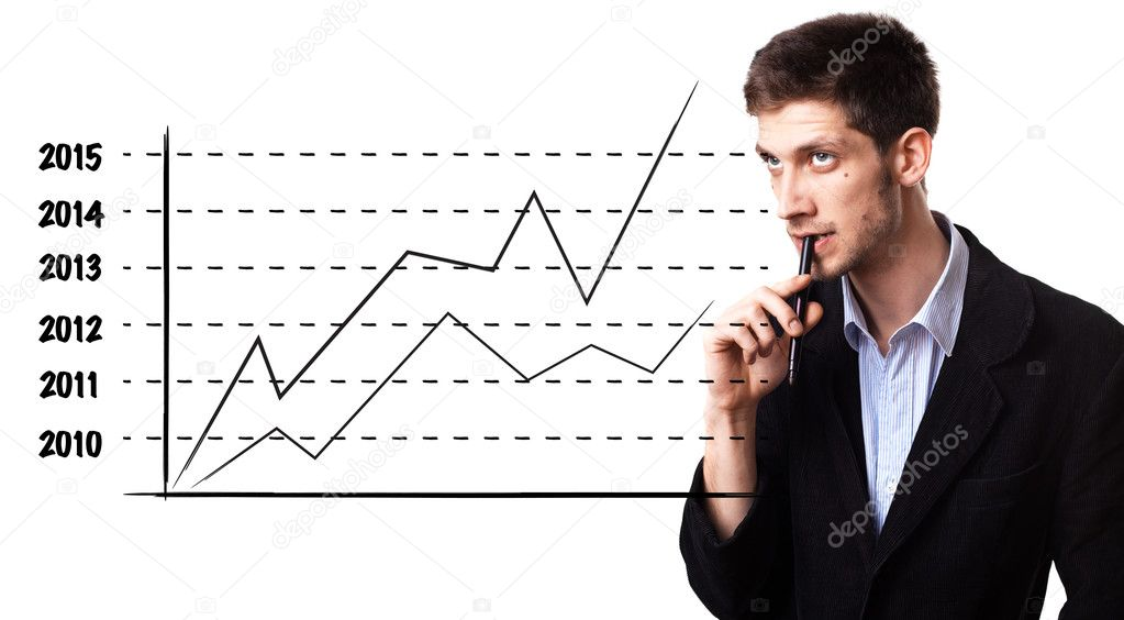 Young man analysing graph on the whiteboard  Stock Photo #5347792
