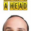 "Man with ""CONSTRUCTION A HEAD"" mark over his head — Stock Photo #5365439"
