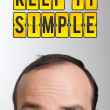 "Man with ""KEEP IT SMILE"" mark over his head — Stock Photo"