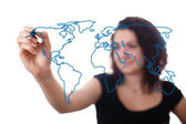 Woman drawing the world map in a whiteboard 2 — Stock Photo