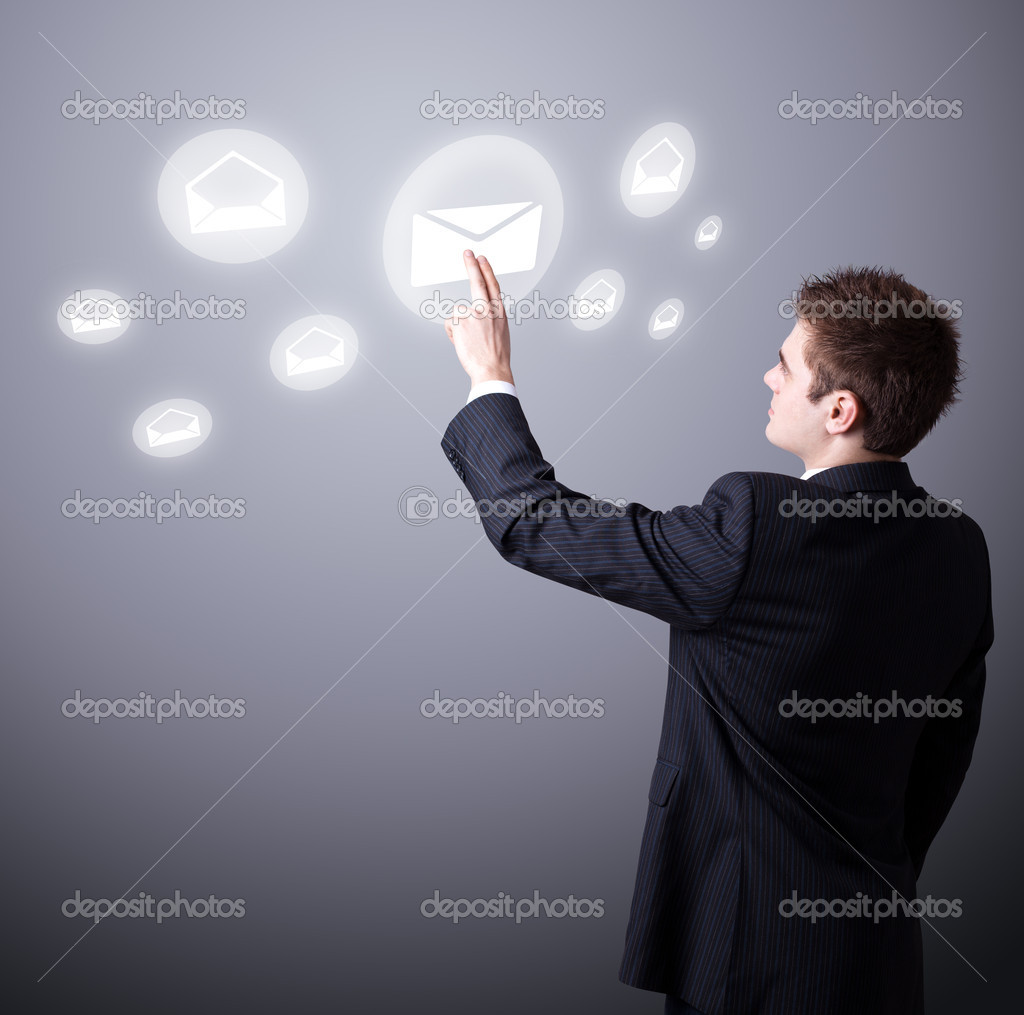 Young business man pressing a touchscreen button — Stock Photo #5366811