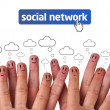 Happy group of finger smileys with social network icon - Stock Photo