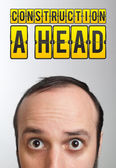"Man with ""CONSTRUCTION A HEAD"" mark over his head — Stock Photo"