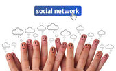 Happy group of finger smileys with social network icon — Stockfoto