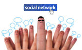 Happy group of finger smileys with social network icon — Stock Photo