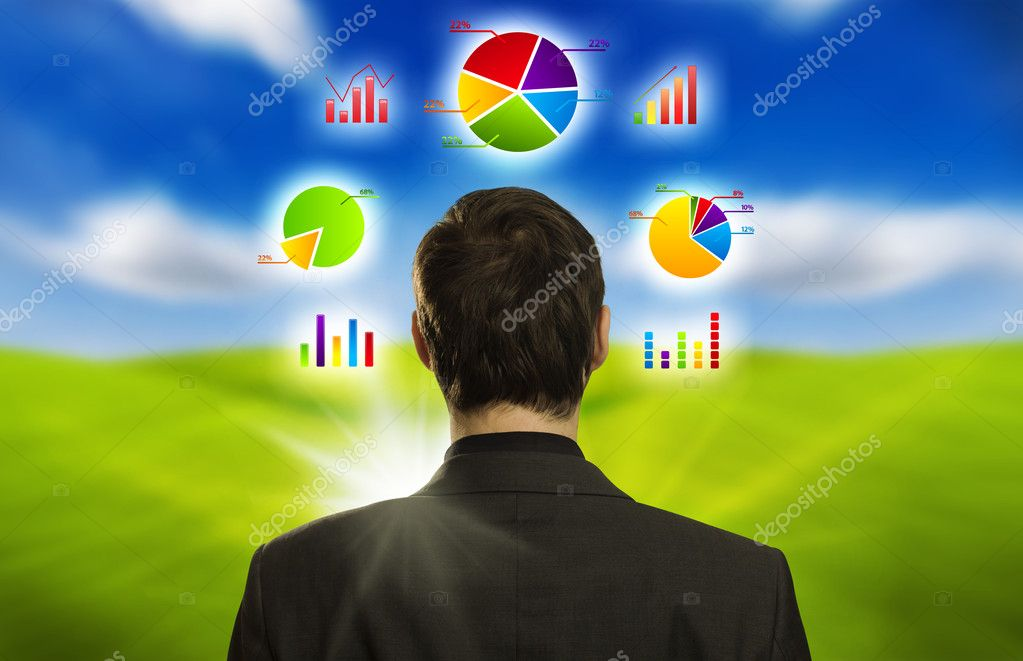 Young businessman with pie charts floating around his head — Stock Photo #5377075