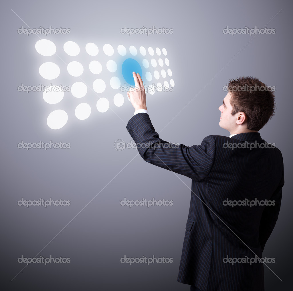 Young business man pressing a touchscreen button — Stock Photo #5377109