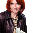 Cheerful young lady holding cash and smiling - Stock Photo