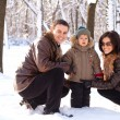 Attractive family having fun in a winter park — Stock Photo #4546677