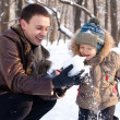 Father and son having fun in the Winter Park — Stock Photo