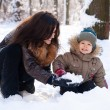 Mother and son having fun in the Winter Park — Stock Photo #4546686