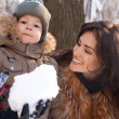 Mother and son having fun in the Winter Park — Stock Photo