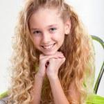 Little blond girl smiling — Stock Photo